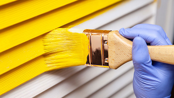 Painting a House Yellow